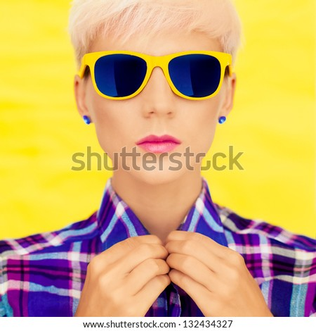 fashion portrait of a girl in fashion sunglasses - stock photo