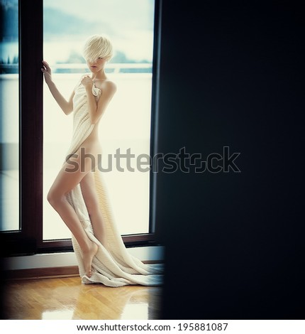 Fashion portrait of a sensual girl in a luxurious room - stock photo