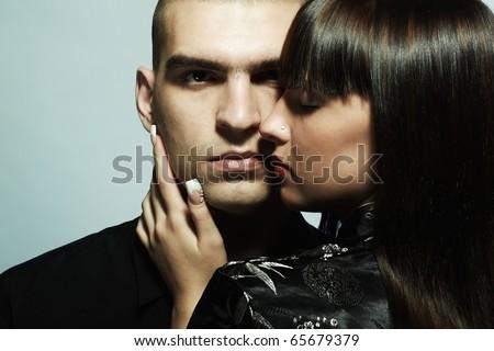 Fashion portrait of a young beautiful couple - stock photo