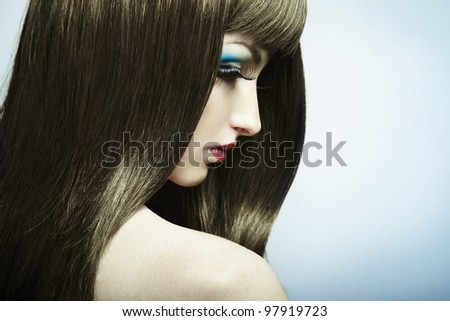 Fashion portrait of a young beautiful dark-haired woman. Close-up - stock photo