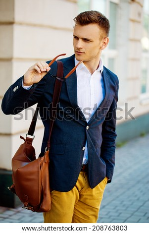 Fashion portrait of a young casual man looking away from the camera. Street photo.  - stock photo