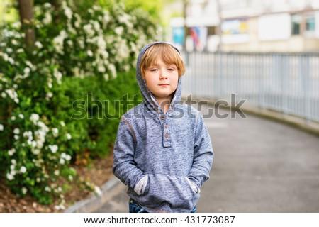Fashion portrait of adorable little boy of 4-5 years old wearing blue sweatshirt - stock photo