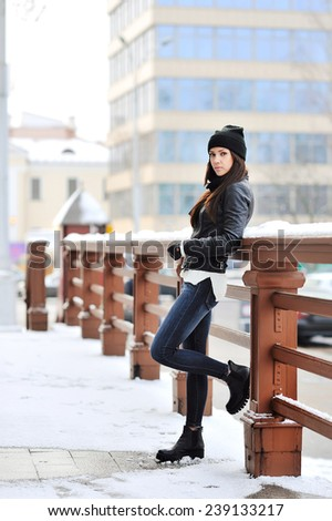 Fashion portrait of attractive young woman in winter  - stock photo