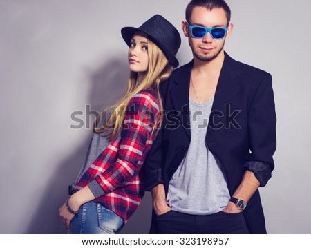 fashion  portrait of beautiful couple together.  Hipster boy and girl.  - stock photo