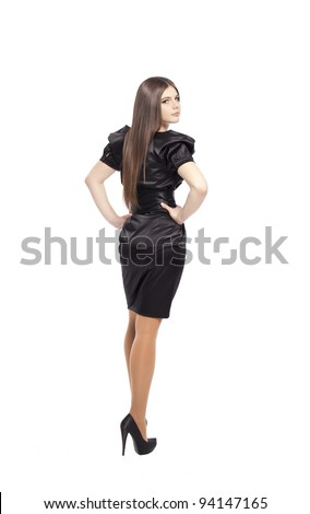 Fashion portrait of beautiful girl teenager woman in black silk evening dress glossy brown hair, isolated on white background - stock photo