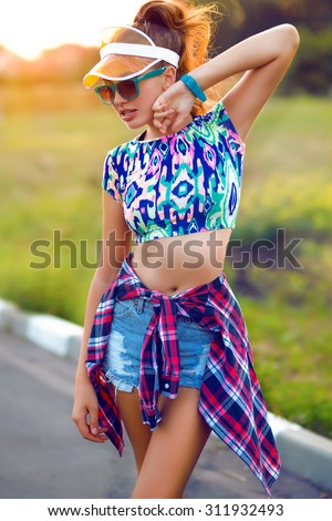 Fashion portrait of beautiful hippie young woman wearing boho chic clothes and summer hat outdoors.Soft warm vintage color tone.Fashion brunette model in nice clothes.Wearing coat,handbag,ripped jeans - stock photo