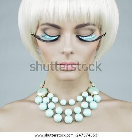 Fashion portrait of beautiful lady with mint eyelashes and necklace - stock photo