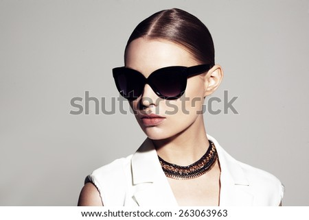 fashion portrait of beautiful model with sunglasses  - stock photo