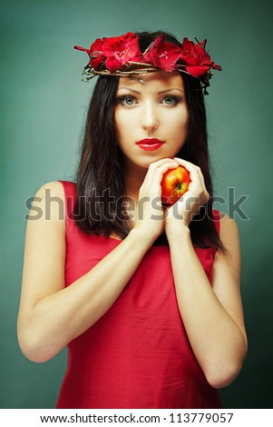 Fashion portrait of beautiful woman in red - stock photo