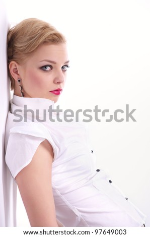 Fashion Portrait of beautiful woman leaning against the wall - stock photo