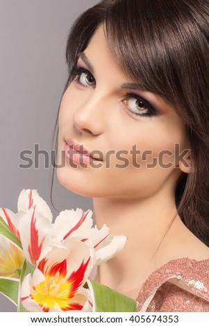 Fashion portrait of beautiful young woman. Beauty Girl with flovers. Beautiful Young Woman with Fresh Clean Skin, Beautiful Face. Perfect Skin. - stock photo