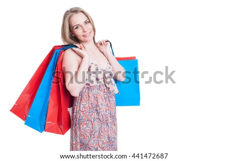 Fashion portrait of cheerful young woman holding shopping bags with copyspace isolated on white background - stock photo