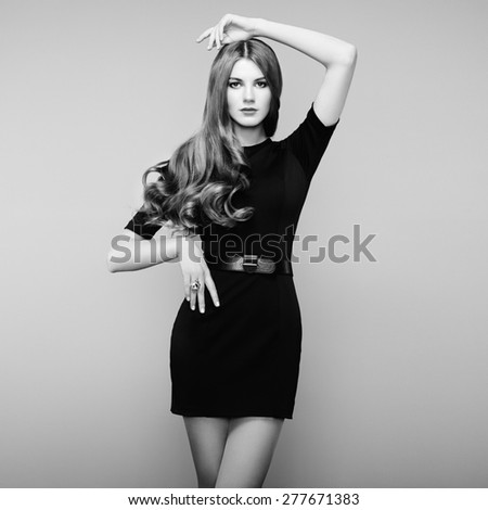 Fashion portrait of elegant woman with magnificent hair. Blonde girl. Perfect make-up. Black and white - stock photo