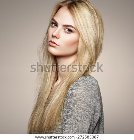 Fashion portrait of elegant woman with magnificent hair. Blonde girl. Perfect make-up. Hairstyle - stock photo