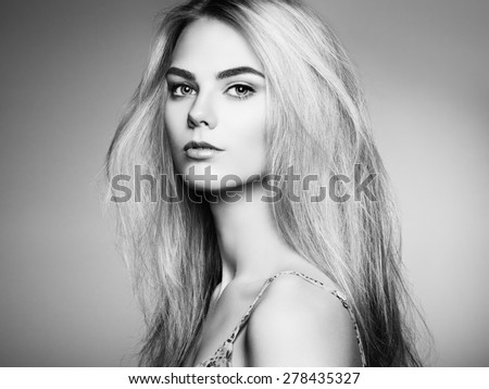 Fashion portrait of elegant woman with magnificent hair. Blonde girl. Perfect make-up. Hairstyle. Black and white - stock photo