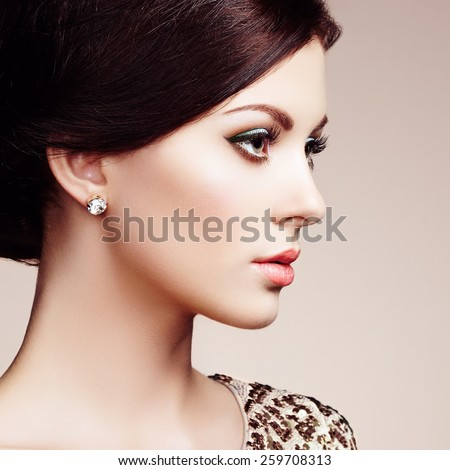 Fashion portrait of elegant woman with magnificent hair. Brunette girl. Perfect make-up - stock photo