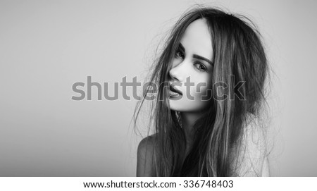 Fashion portrait of elegant woman with magnificent hair. Redhead girl. Perfect make-up. Hairstyle. Black and white - stock photo