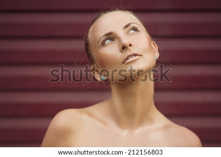 Fashion portrait of fresh young girl with shiny skin - stock photo