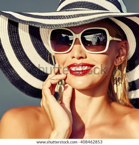 Fashion portrait of glamour sensual young stylish lady wearing hat and sunglasses - close up - stock photo