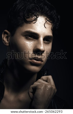 Fashion portrait of handsome young man against grey background - stock photo