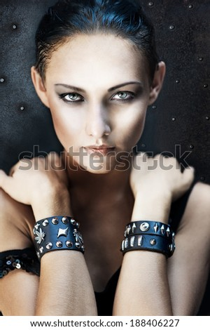 Fashion portrait of pretty young girl in heavy metal style  - stock photo