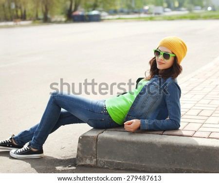 Fashion portrait of pretty young girl in sunglasses outdoors - stock photo