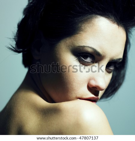 Fashion portrait of sensual woman with predatory sight - stock photo