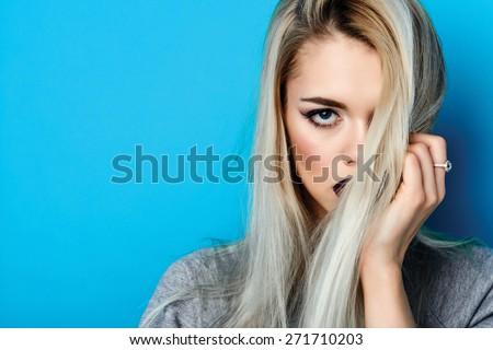 Fashion portrait of sexy blond woman - stock photo
