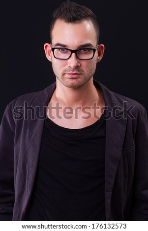 fashion portrait of the young beautiful man - dark background - stock photo