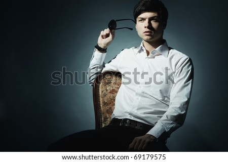 Fashion portrait of the young businessman. Shooting in studio - stock photo