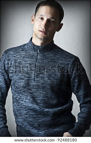 Fashion portrait of Young adult sexy handsome man in dark blue shirt - stock photo