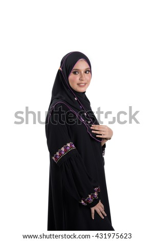 Fashion portrait of young beautiful asian muslim woman with wearing hijab smile while standing against white background. Selective focus. - stock photo