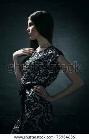 Fashion portrait of young beautiful elegant woman in the black dress - stock photo