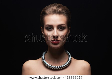 fashion portrait of young beautiful sexy woman in jewelry.Beauty girl with short hair and make-up.elegant lady - stock photo