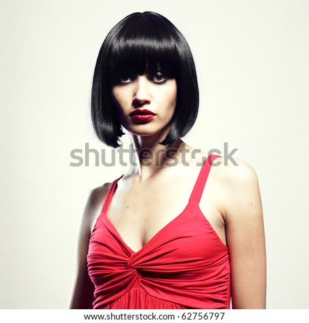 Fashion portrait of young beautiful woman with strict hairstyle - stock photo