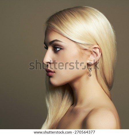 fashion portrait of Young blond woman.Beautiful Girl with healthy hair - stock photo