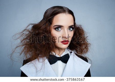 Fashion portrait of young gorgeous brunette with hairstyle. Girl with red lips - stock photo