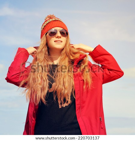 Fashion portrait of young hipster woman with hat and sunglasses on the beach at sunset, retro style color tones - stock photo