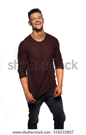 Fashion portrait of young man in red jumper on white - stock photo