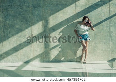 Fashion portrait of young model posing by the wall, hipter style - stock photo