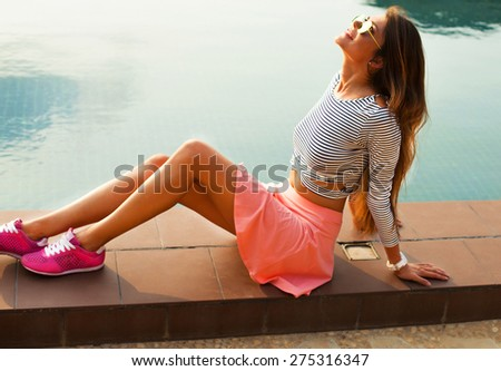 Fashion portrait of young sensual brunette woman with long amazing curled hairs, natural make up.Amazing and sunshine model in summer outfit and reflected sunglasses - stock photo