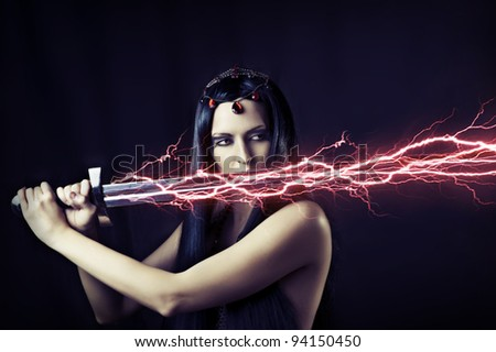 Fashion portrait of young sexy brunette woman - storm. Weather - flash lightning on her sword. mythology, fairytale or fantasy world. - stock photo