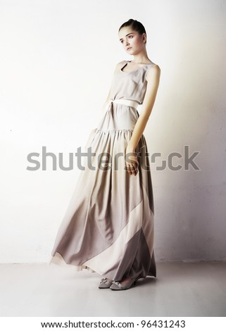 Fashion portrait of young stylish girl in contemporary prom dress - stock photo