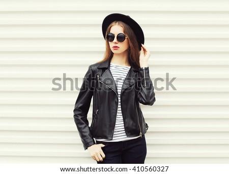 Fashion portrait pretty woman in black rock style over white background - stock photo