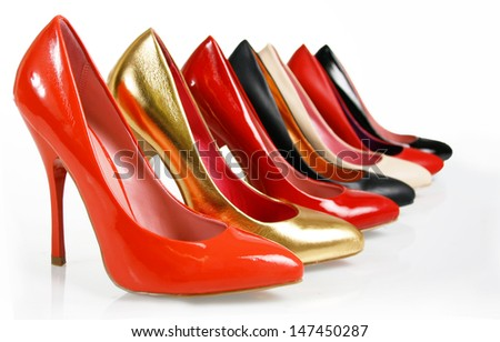 Fashion pumps shoes collection on white background - stock photo