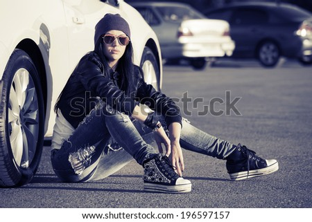 Fashion punk woman sitting at the car - stock photo