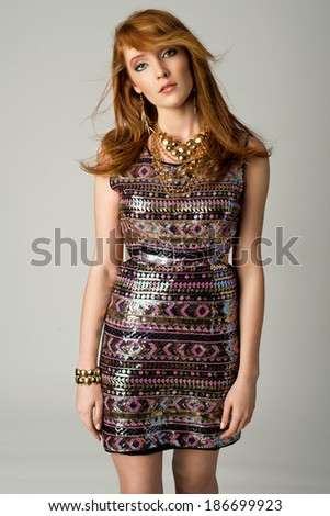 Fashion red-head woman portrait. Female, young model. Studio isolated, gray background  - stock photo