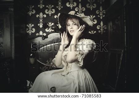Fashion retro portrait of pretty young woman - stock photo