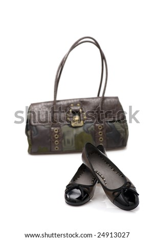 Fashion series: woman's black shoes and suitcase over white - stock photo