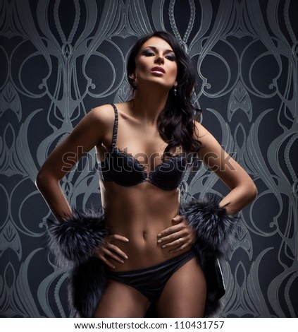 Fashion shoot of beautiful woman in luxury lingerie - stock photo